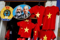 Images of the revolutionary icons Karl Marx and Vladimir Lenin are seen next to t-shirts at a shop in Hanoi, Vietnam January 30, 2019. REUTERS/Kham